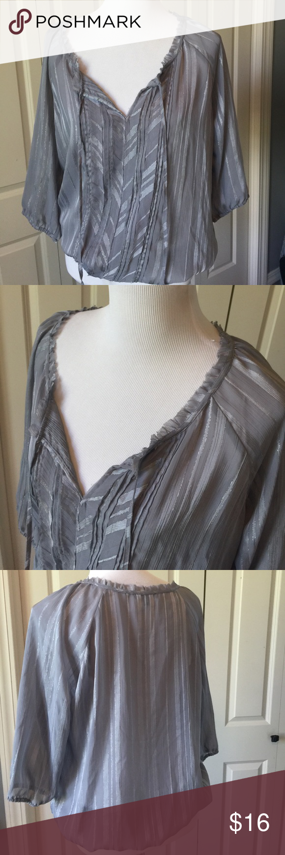 Gray and silver sheer express blouse Ties at the front. Elastic sleeves and waistband. 100% polyester. MR Express Tops Blouses