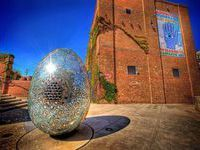 The American Visionary Art Museum is located in the neighborhood of Federal Hill. This museum is dedicated to exhibiting and preserving visionary art. The museum has an area for an exhibition of 67,000 square feet and displays about 4,000 artworks.