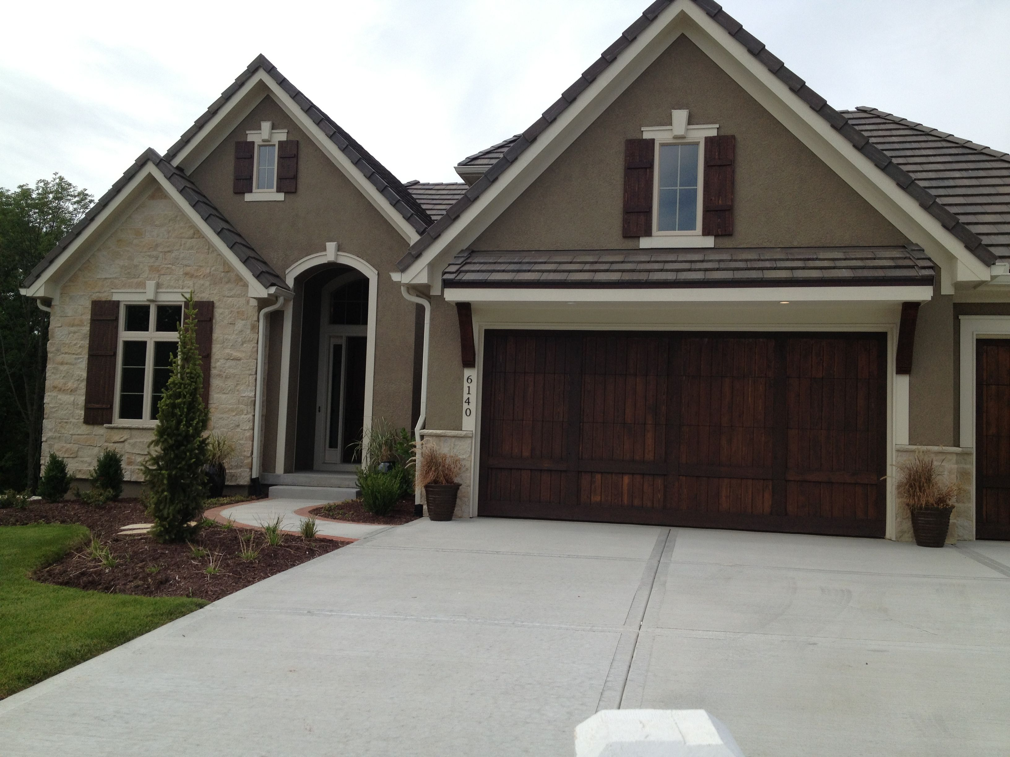 Like exterior colors wood garage door no visible hardware and wood shutters exterior for Exterior garage doors