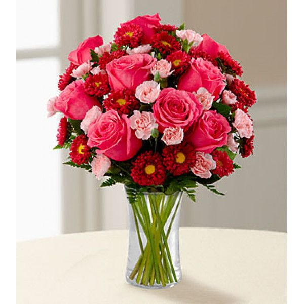 It Is A Blushing Display Of Loving Kindness Fuchsia Roses Are Sweetly Stunning Amongst Red Matsumoto Asters Flower Delivery Ftd Flowers Flower Arrangements