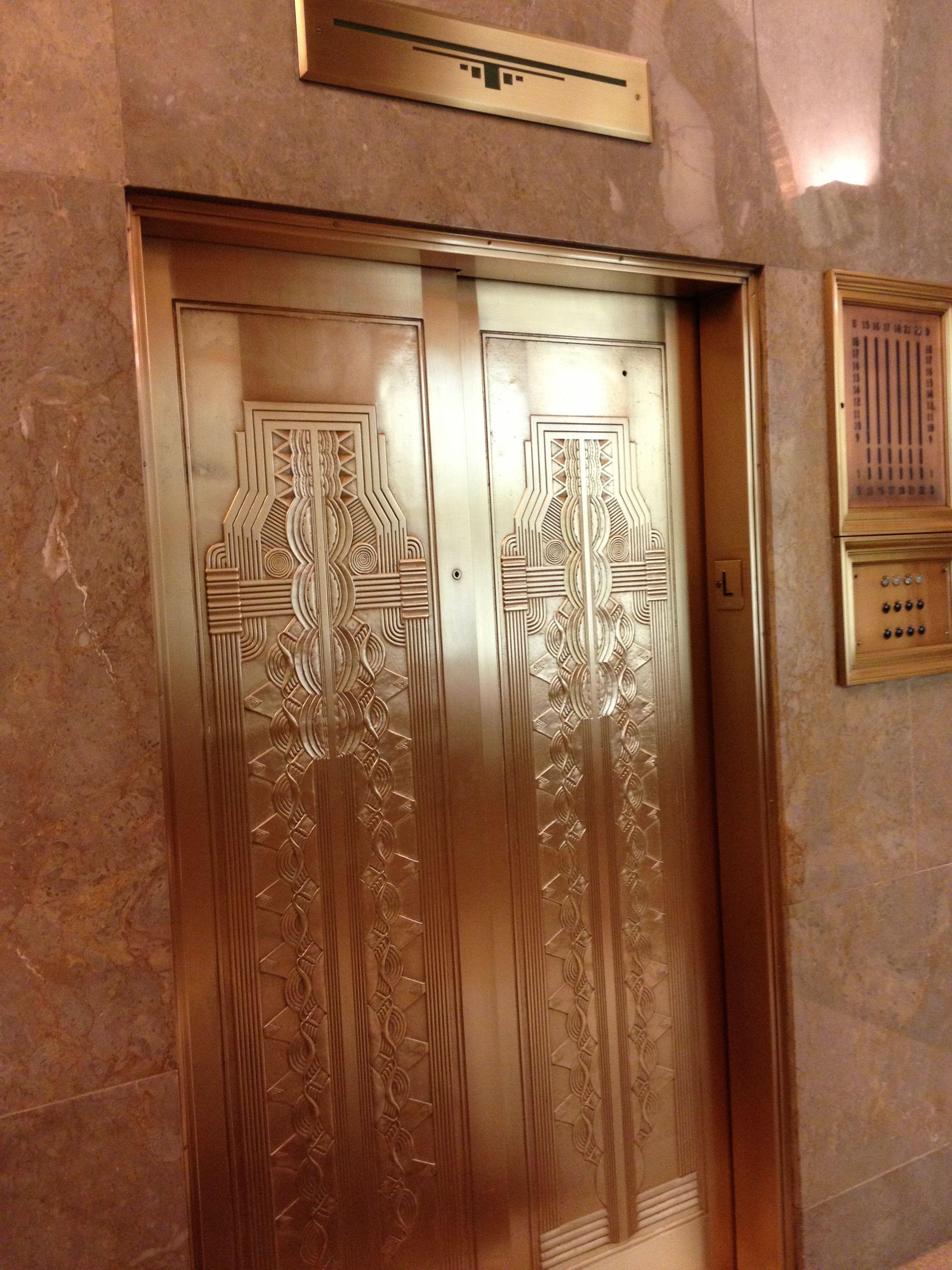 Art deco polished brass elevator doors park avenue new york city