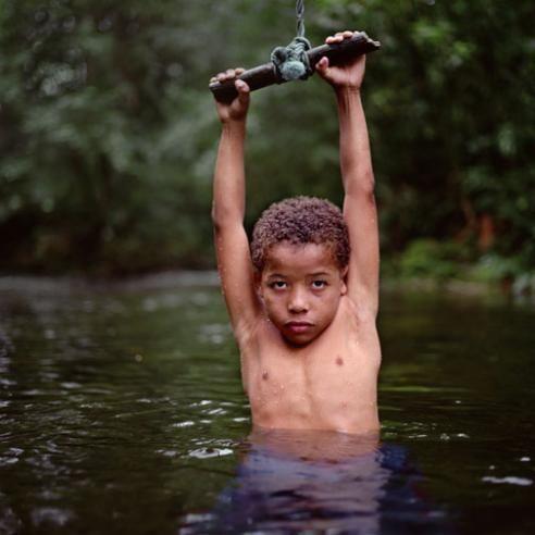 Title: Emerging Boy, 2009  Artist: Mona Kuhn (1969, Brazilian/German)  Year: 2009
