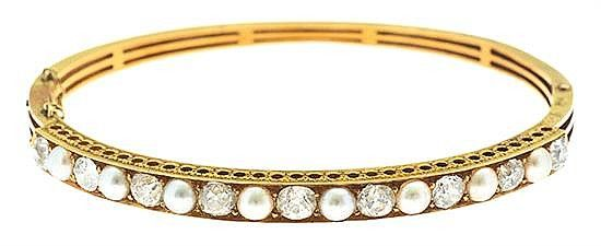 A VICTORIAN DIAMOND AND PEARL BANGLE