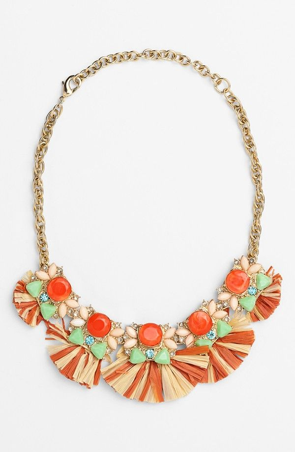 Love the addition of colorful raffia to this coral and mint stone statement necklace.