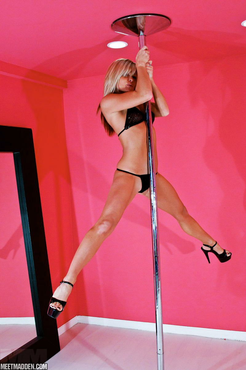 Hot blonde works the stripper pole