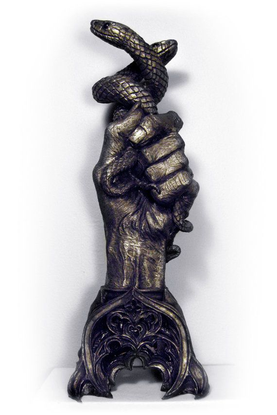 Hand of Glory: This occult artifact was made from the severed left hand of a hanged criminal and was thought to produce magical effects of use to thieves. When a candle is placed and lit within the Hand of Glory, it gives light only to the bearer, any he comes across will be put to sleep, and it could unlock doors.