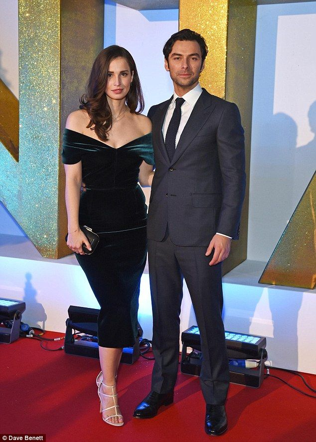 Perfect pair! Joined by handsome co-star Aidan Turner, the 27-year-old actress looked simply stunning in an off-the-shoulder gown, crafted in a sultry velvet fabric