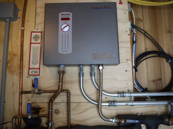 Tankless Water Heater Showing Water Connections And Electrical Conduit Connections Water Heater Installation Heating Air Conditioning Solar Powered Attic Fan