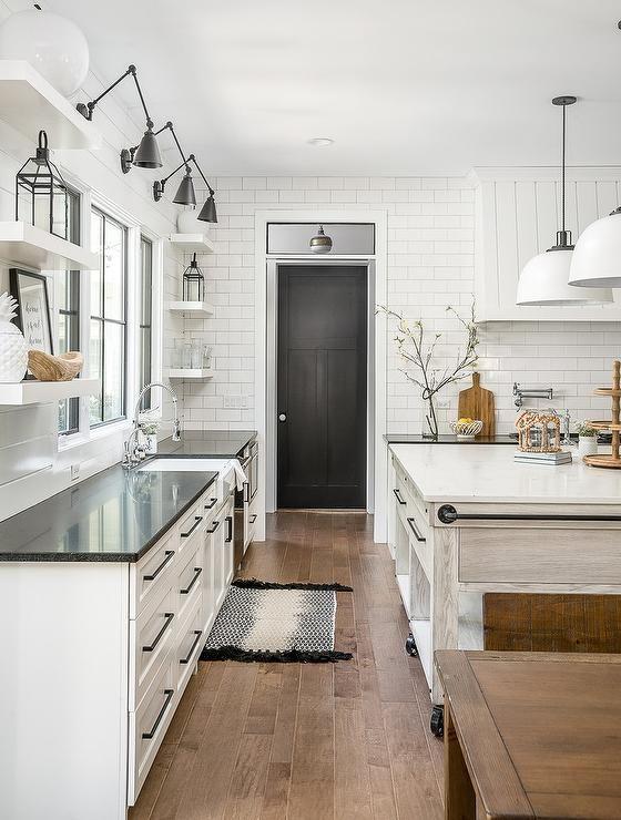 Black door leading to utility area? White cottage kitchen ...