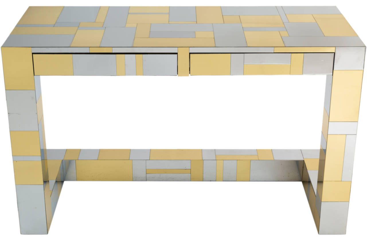 "Functional desk designed by Paul Evans for the "" Cityscape series"" in mixed patchwork of chromed steel and brass veneers. Desk with 2 drawers on cantilevered base. A few typical minor dings and blemishes to surface."