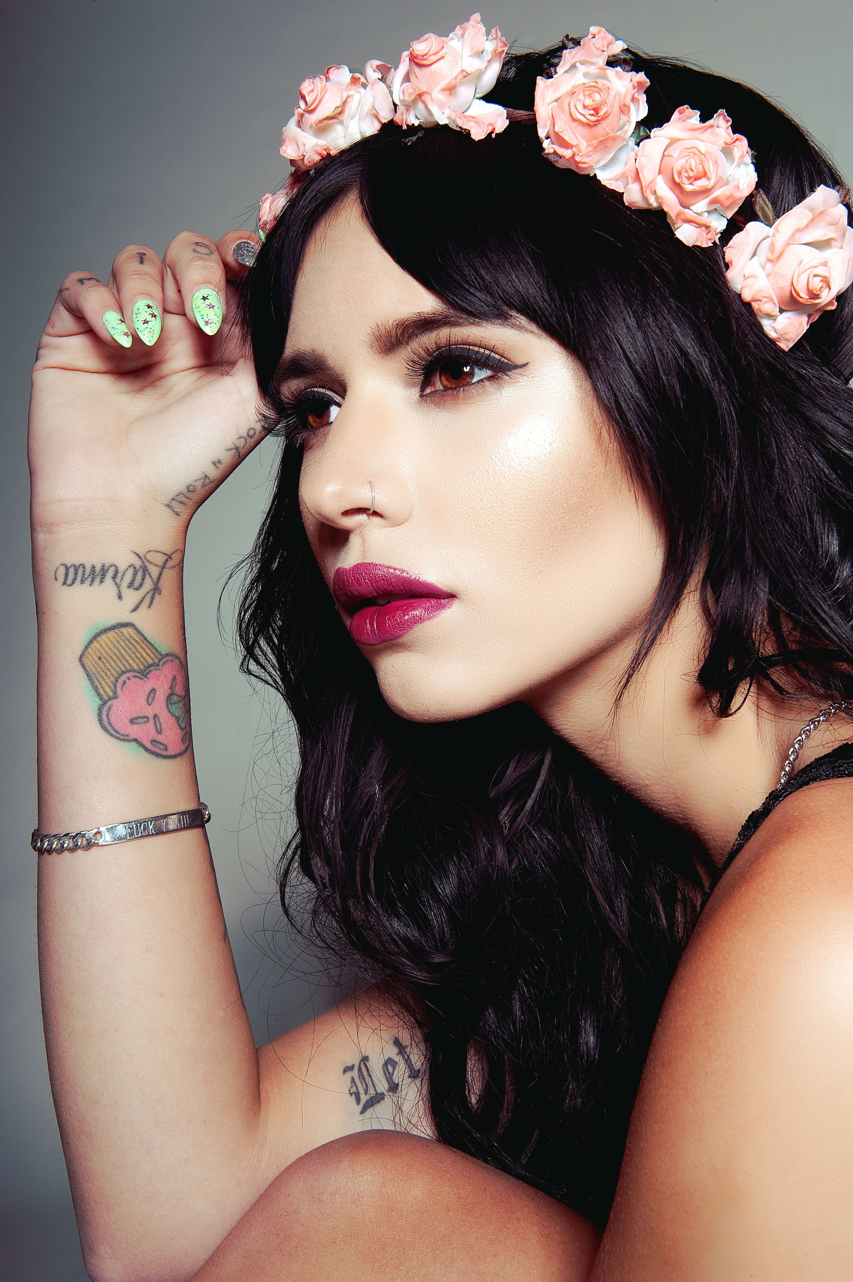 Pink Flower Crown Black Hair Tattooed Fierce Makeup Light Green