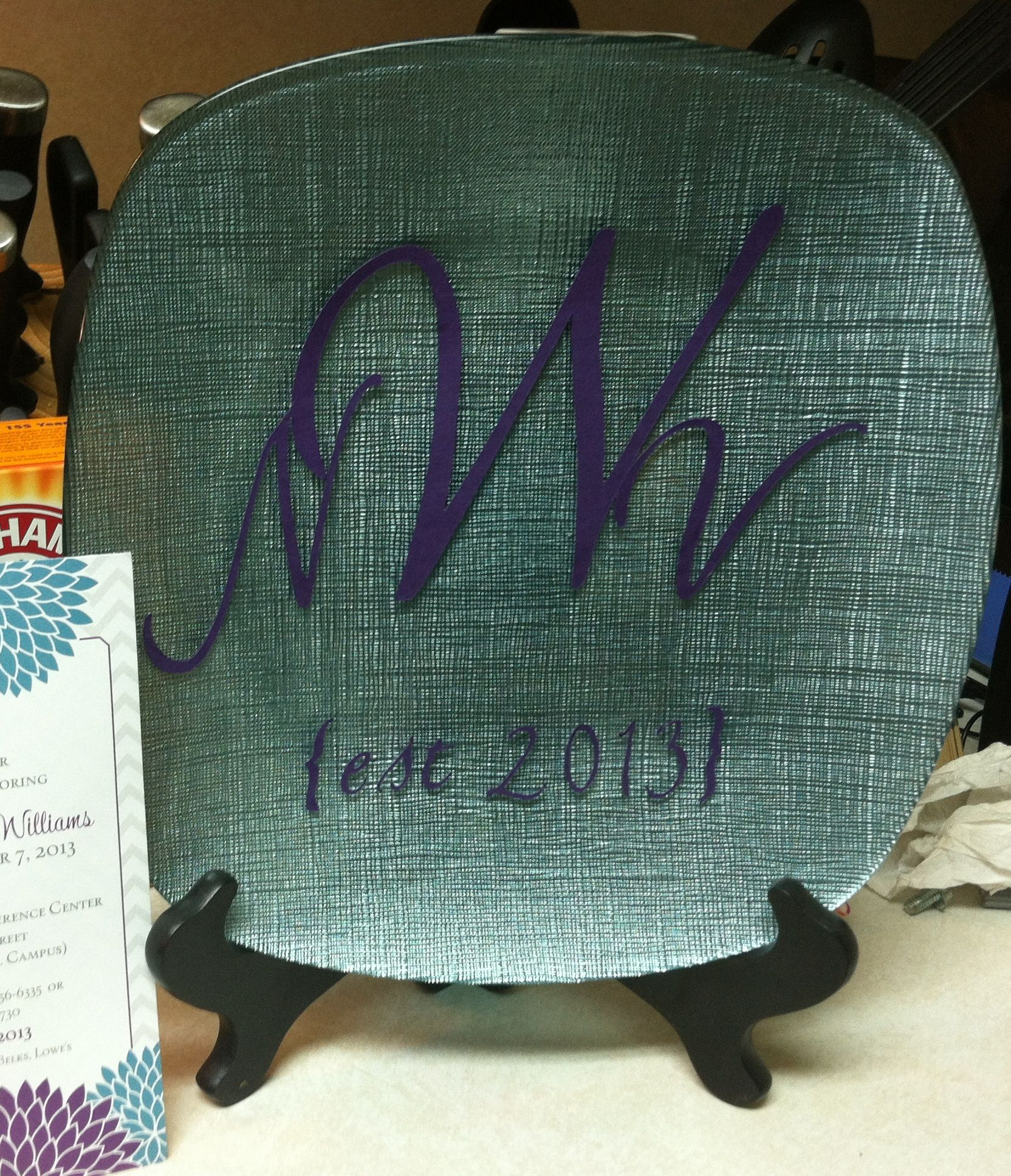 DIY Wedding gift!!!  Find plate/charger color of friends wedding (this is a Jessica McClintock plate) Cut out monogram of bride and grooms name & year getting married  Attach to plate using glue stick Apply mod podge and let dry!!!  This is a fantastic way of personalizing a gift for the newlyweds to cherish!!