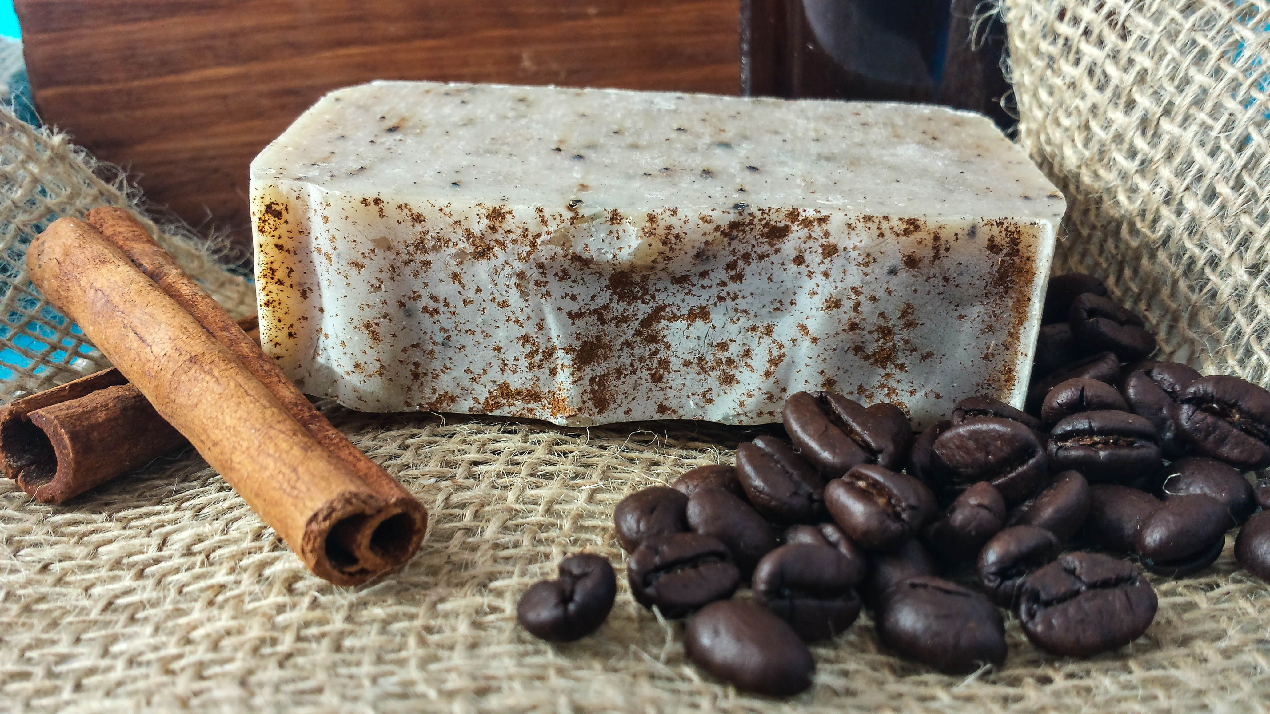 Handcrafted cinnamon coconut milk soap with organic ground