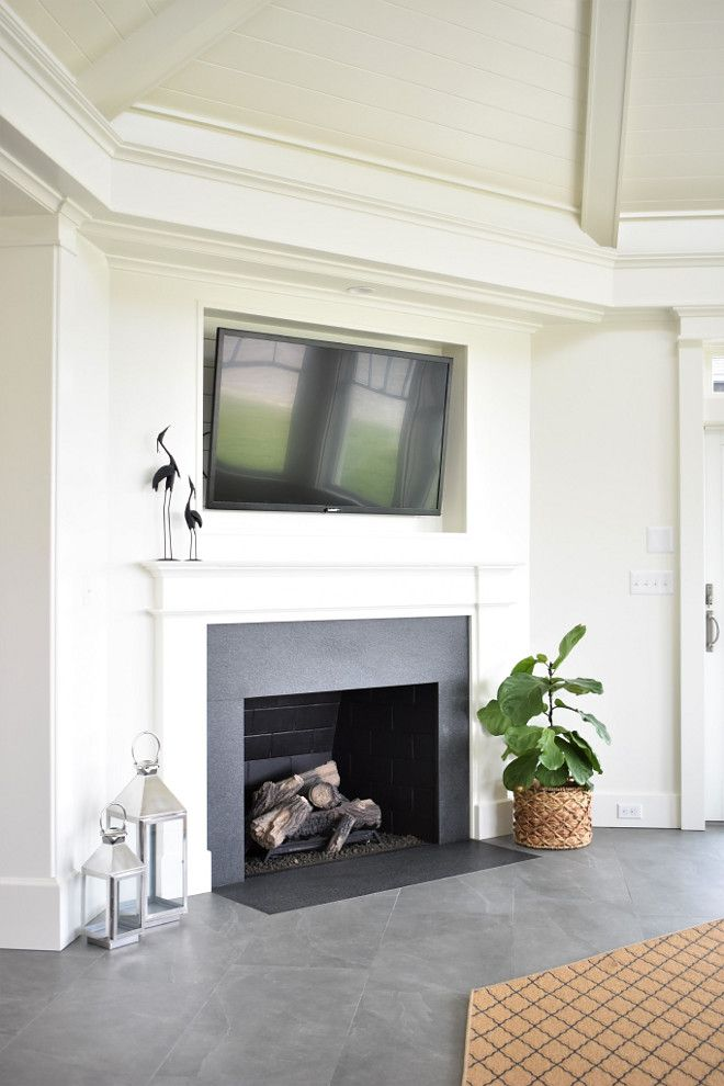 A Sleek Fireplace With Tv Niche And Tongue And Groove Ceilings Sleek Fireplace White Kitchen Design Fireplace Design