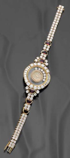 PHILLIPS : CH060208, Chopard, A 'Happy Diamond' Diamond and Ruby Lady's Wristwatch