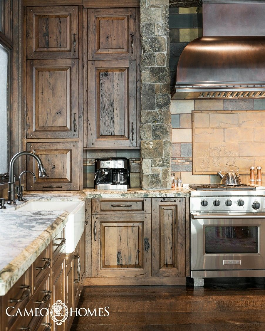 An upscale mountain rustic kitchen in this mountain home ...
