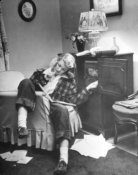 teenager pat woodruff pondering homework while listening to the radio in the living room st