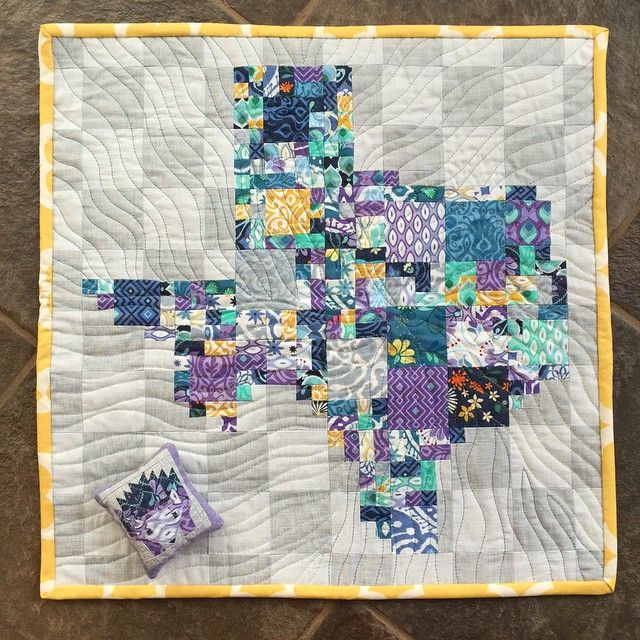 """my #schnitzelandboominiquiltswap partner loves #katespain and admits to being homesick for the great state of #Texas ... I hope she loves this! Modified from #texasroadtripQAL pattern ... Thanks so much to @prettylittlequilts and @myfabricrelish  18.5"""" square #operationtinytexas #mofakara #makeaquiltmakeafriend #schnitzelandboominiswap #cuzco #katespainfabric  We are going to miss that little Hazel!!! #hazelhedgehogquilt"""
