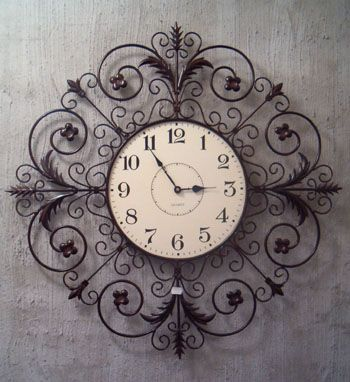 wrought iron clock - outside