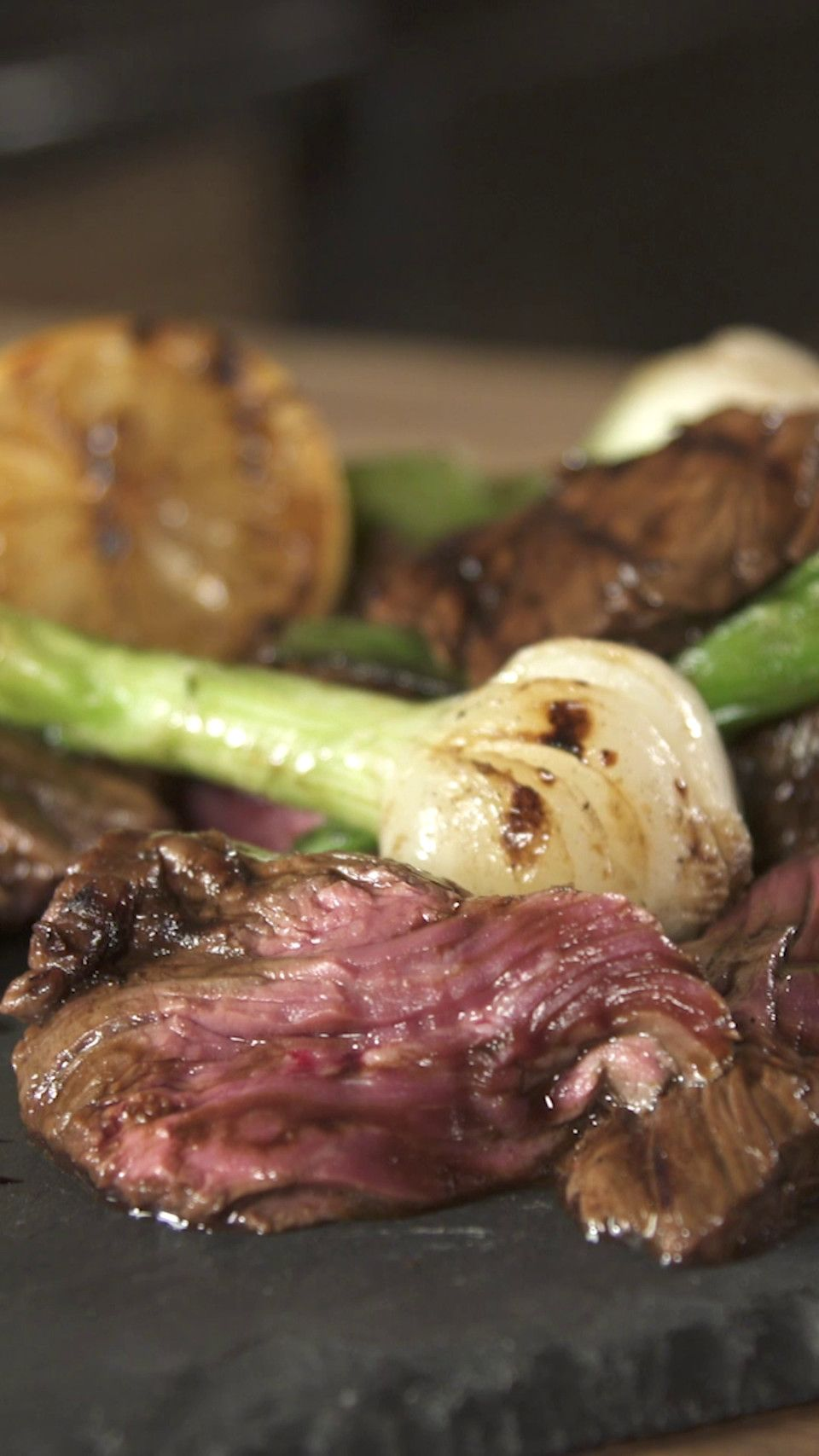 Recipe with video instructions: This juicy recipe of Hanger Steak will impress everyone.  Ingredients: 2-8 oz cut of cleaned hanger steak, 1 oz molasses, 1 oz sherry vinegar, 1 Tbsp smoked sea salt, 2 Tbsp fresh black pepper, 2 lemons, halved, 8 green onions