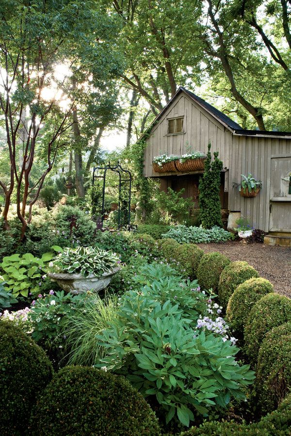 """Without organization, a hundred different perennials can look like yard salad. That's where structures—pathways, evergreens, walls, hedges, edging, small trees, and ponds—come in. They define spaces, direct views, and lend interest even when the garden is dormant. One trick Linda uses is planting boxwoods or other small shrubs to accentuate the arc of a curving bed line. She also plants Japanese maples throughout because they're so architectural. """"They're amazing,"""" she notes. """"They look…"""