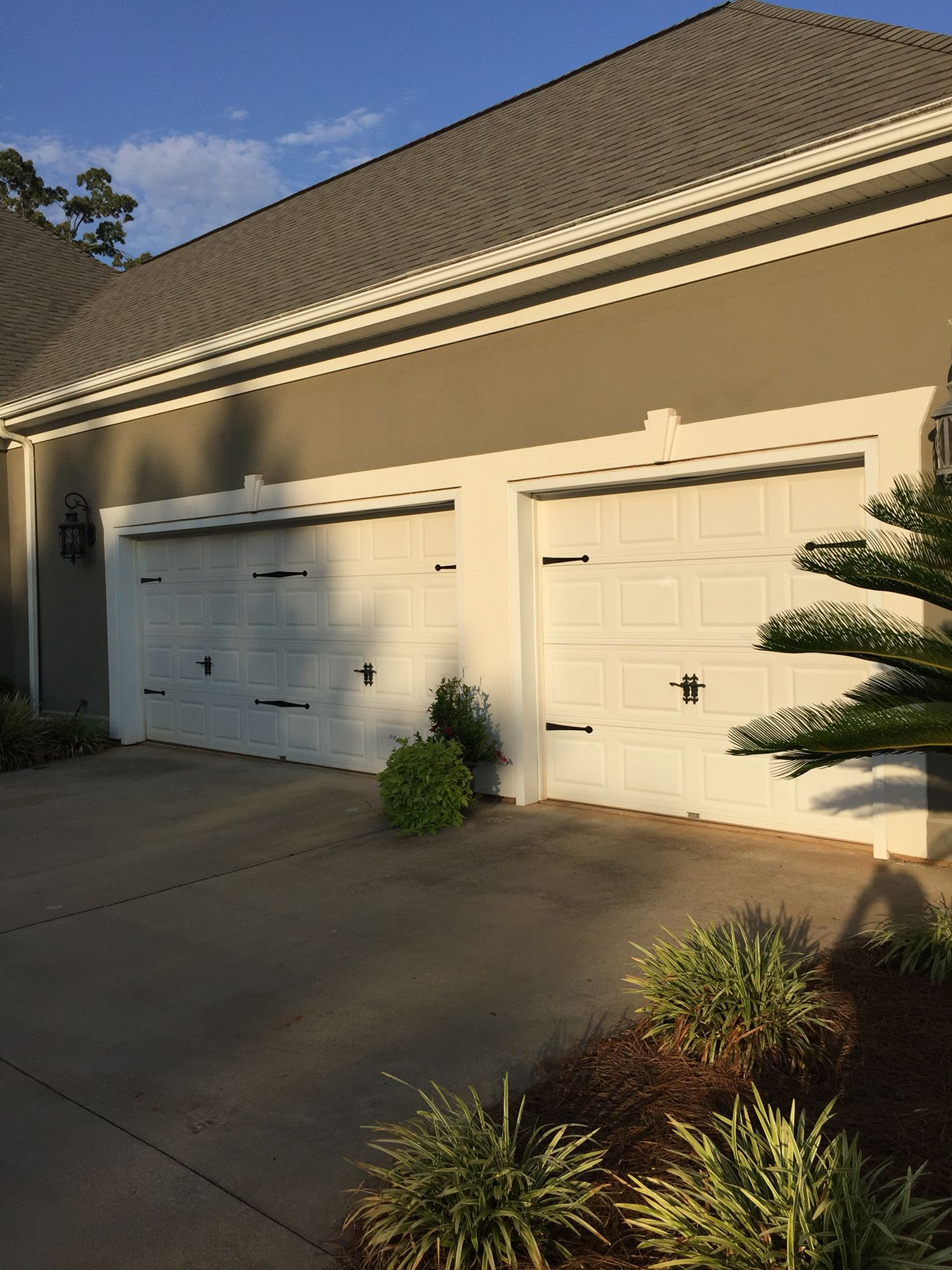 2010 Diy Update Added Iron Hardware On Plain Garage Doors 1 Double 1 Single To Give A Tuscan Vi Garage Doors Garage Door Makeover Double Garage Door