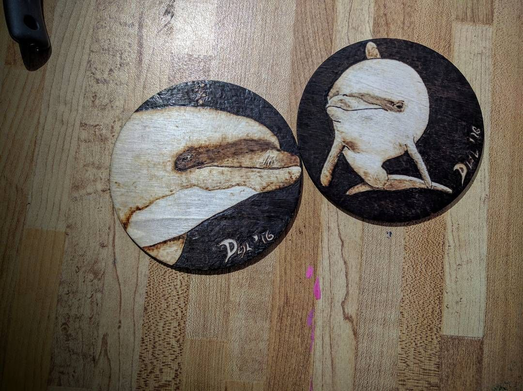 Finished two pieces of this dolphin coaster set! Two more to make!  #dolphins #coasters #pyrography #lockesluckymoonandstars
