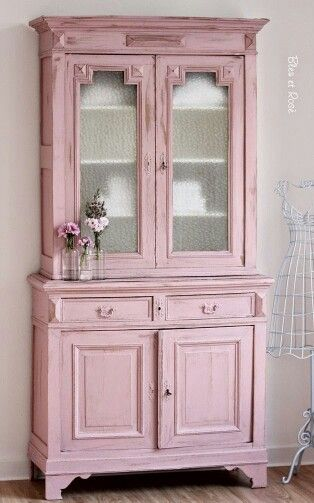 Pretty with linens inside the glass china cabinet doors   pink