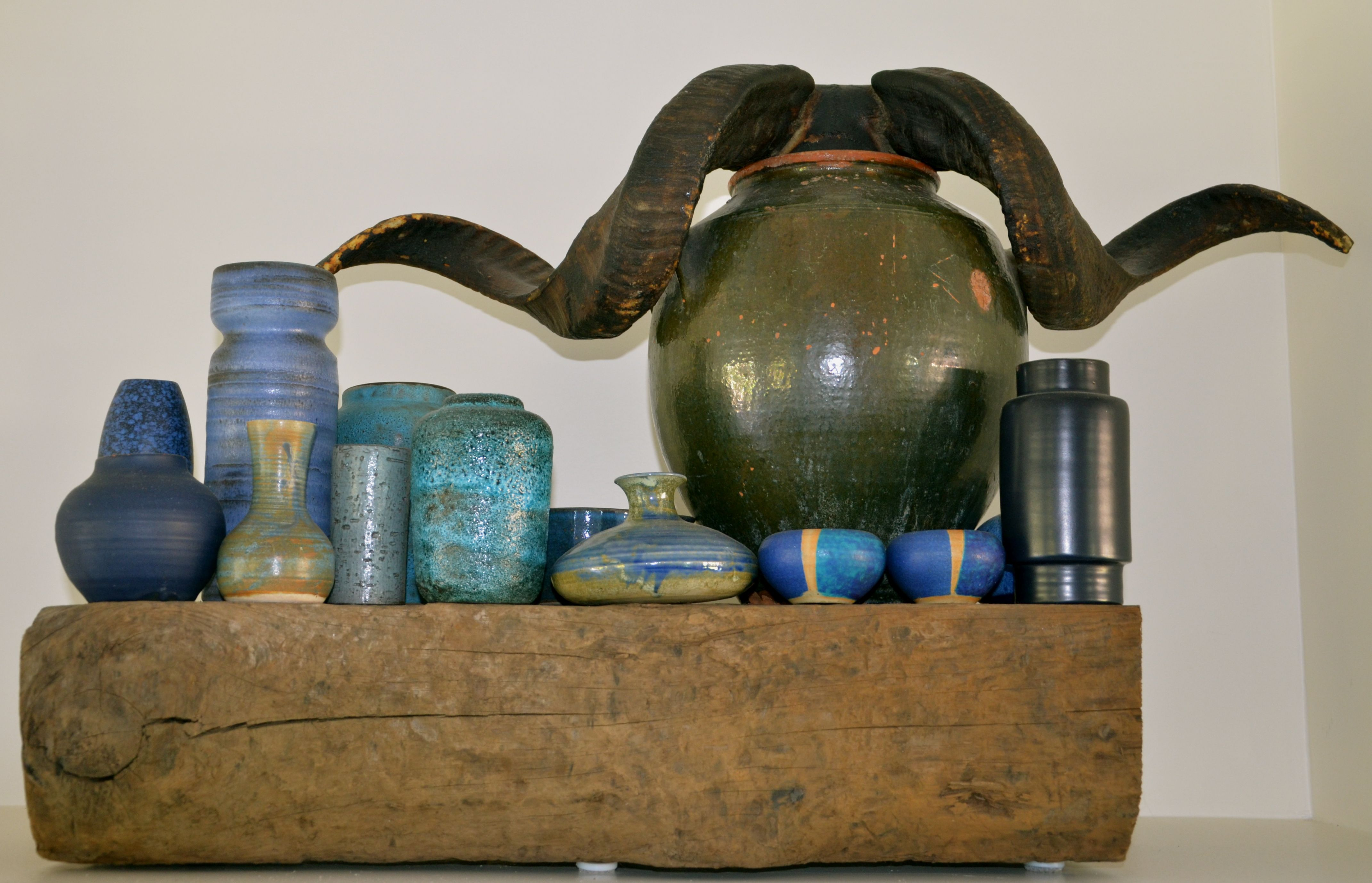 Handmade ceramics from black to light blue