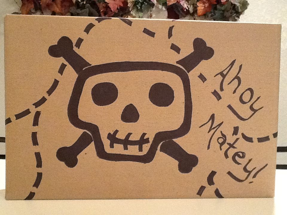 Pirate themed wrap! X marks the spot on the back of the gift. Creative gift wrap ideas!