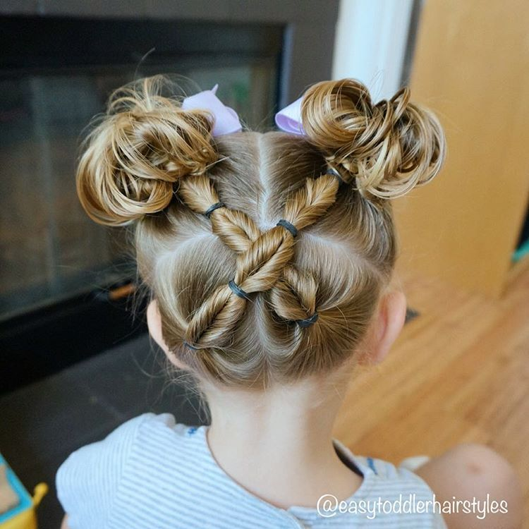 Two faux fishtails crossed up into messy pigtails. Video coming soon on this style and also one on messy pigtail buns.