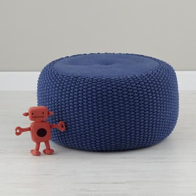 I'd add a second pouf in this rich blue, as well. In a shared space, it's a good idea to consider color-coding some of the items so everyone's on the same page about what belongs to whom.