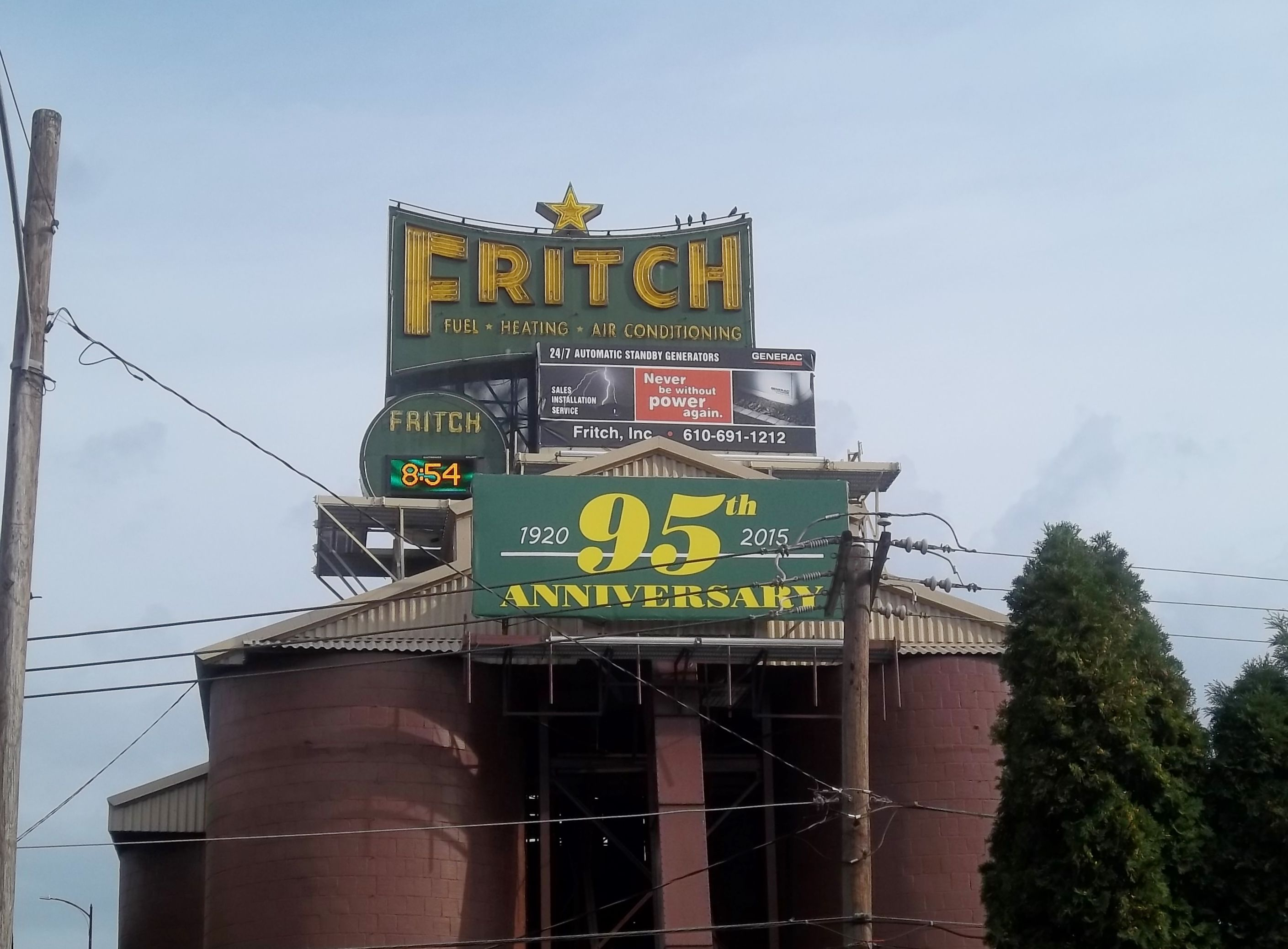 The Iconic Fritch Fuel Time And Temperature Board Next To The Hill