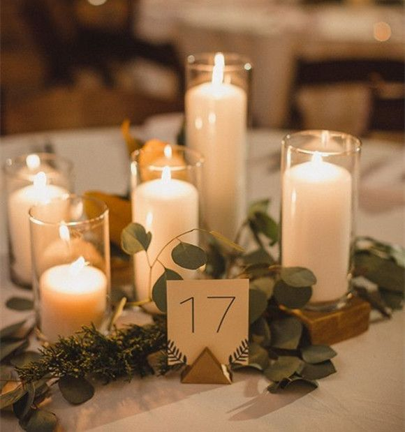Candle Centerpieces With Round Glass Garnished With Leaves   28 Round Table  Centerpieces (in Different Styles)   EverAfterGuide