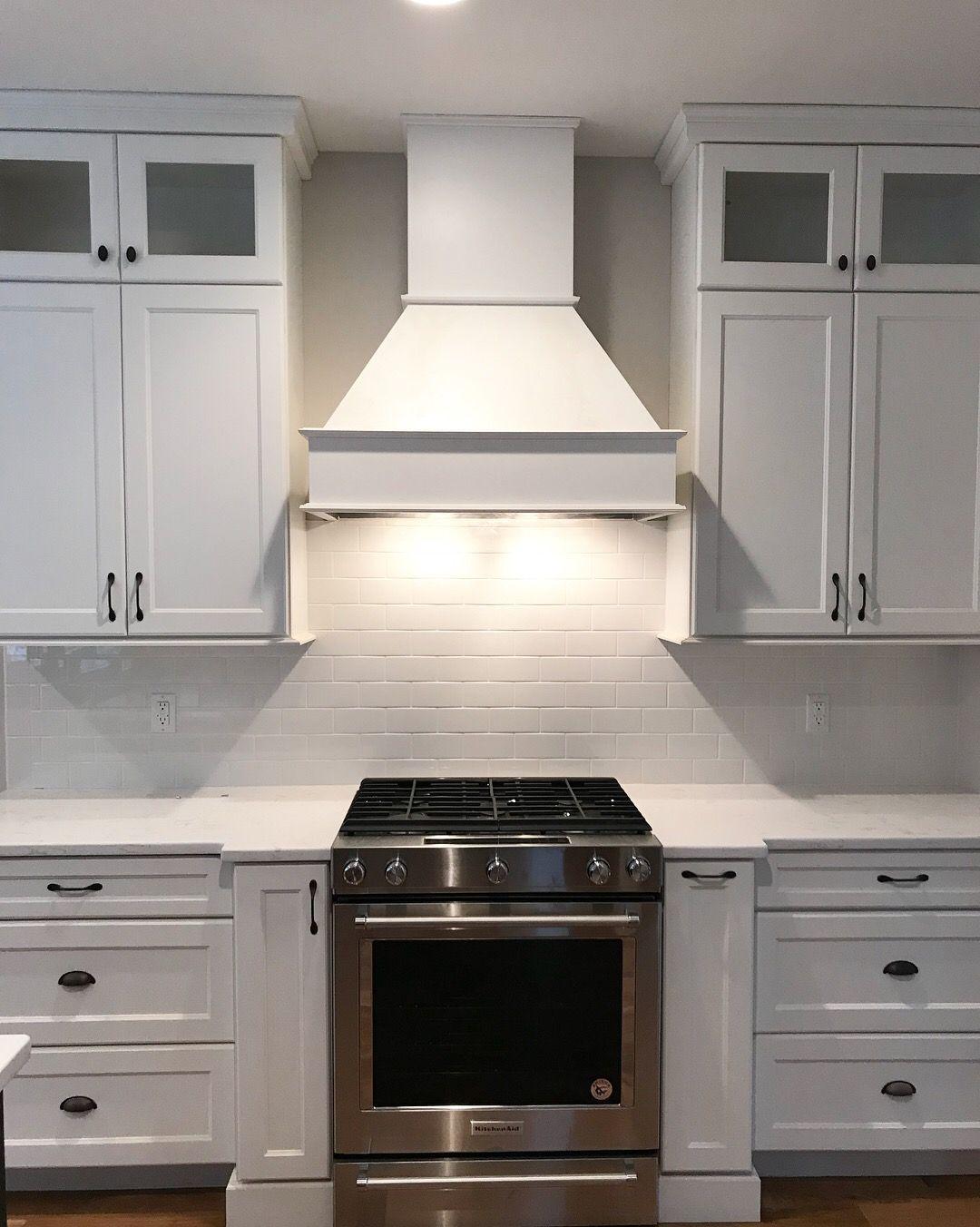 Modern Farmhouse white kitchen with white subway tile backsplash and ...