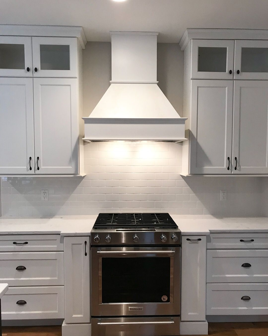 Chimney Hood Backsplash ~ Modern farmhouse white kitchen with subway tile
