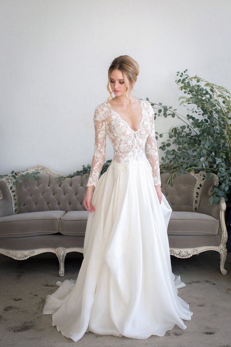 Long sleeved lace wedding dress  Long Sleeved Lace Wedding Dress JINZA Couture Bridal  Wedding Fever