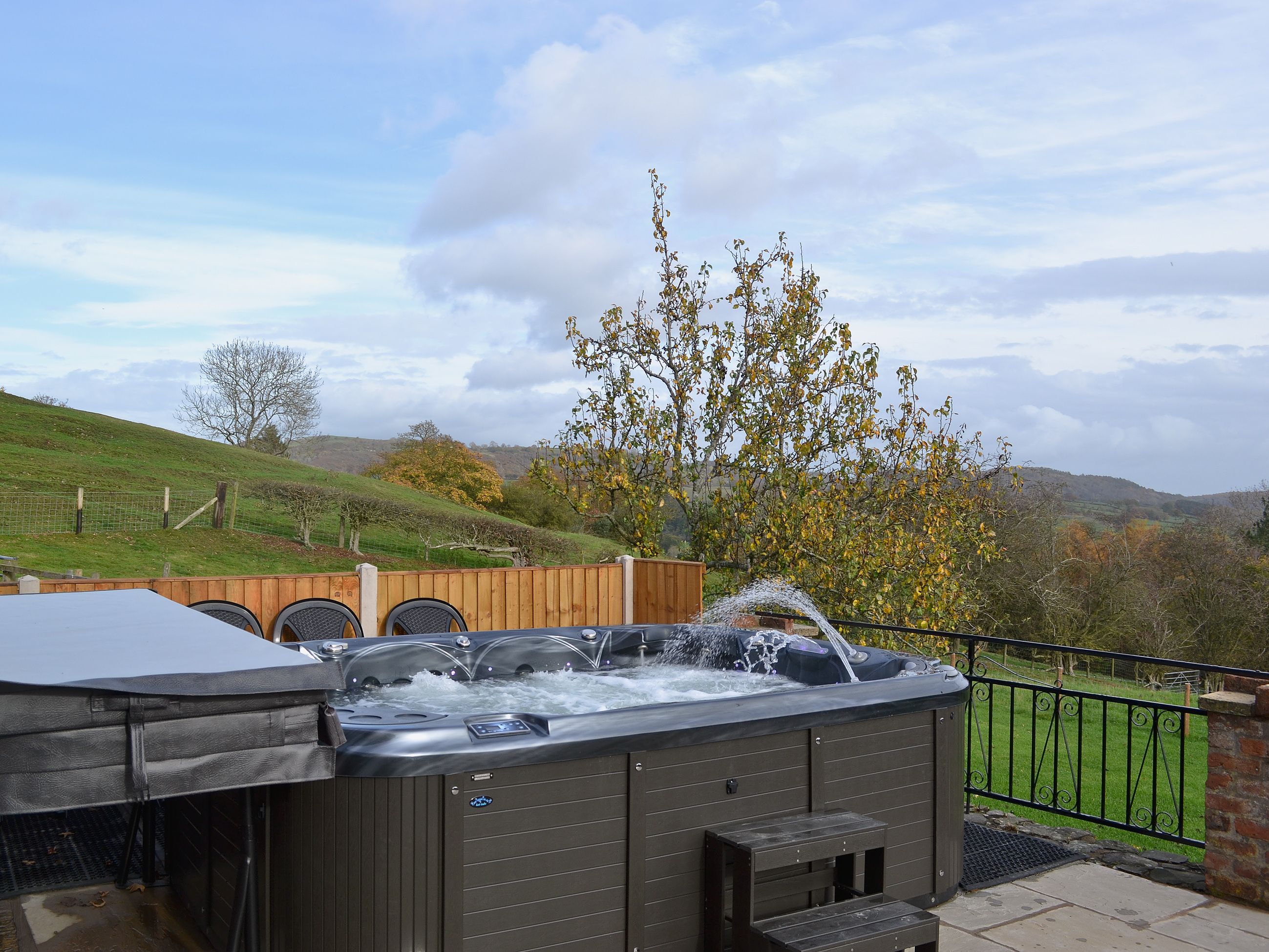 After a long day, relax in the 9-seater hot tub and enjoy the views ...