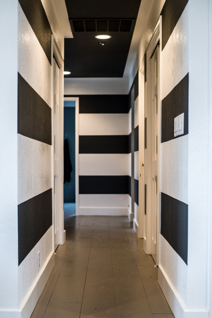 Black and white stripes and a black ceiling in the