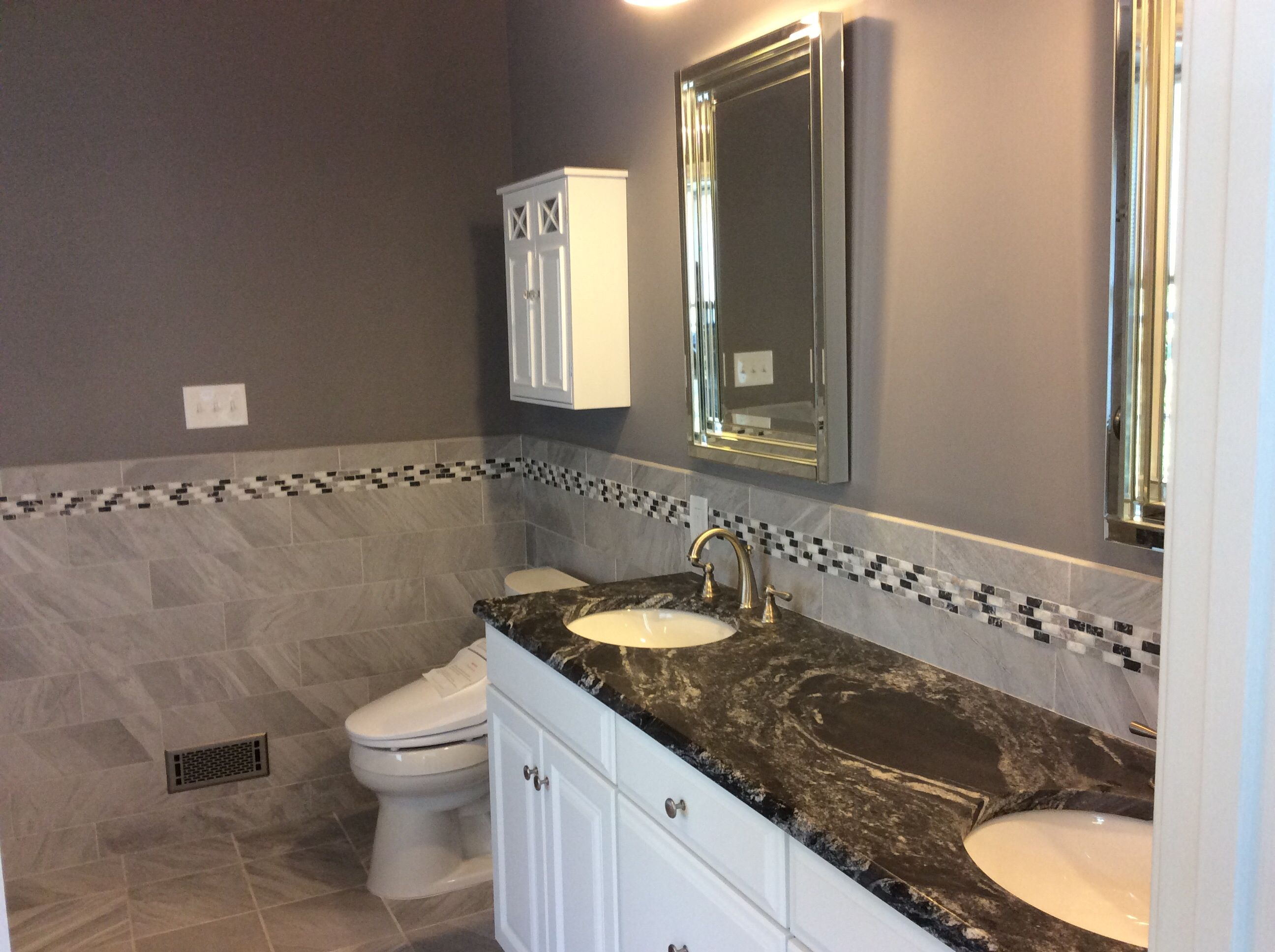 Gorgeous new master bathroom that features Black Forest ... on Bathroom Ideas With Black Granite Countertops  id=35045