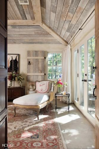 Love all the windows and wood accents. A light, bright, but ...