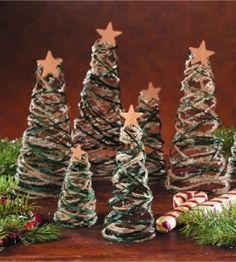 For a rustic looking centerpiece, try your hand at this jute string and raffia Christmas tree craft.