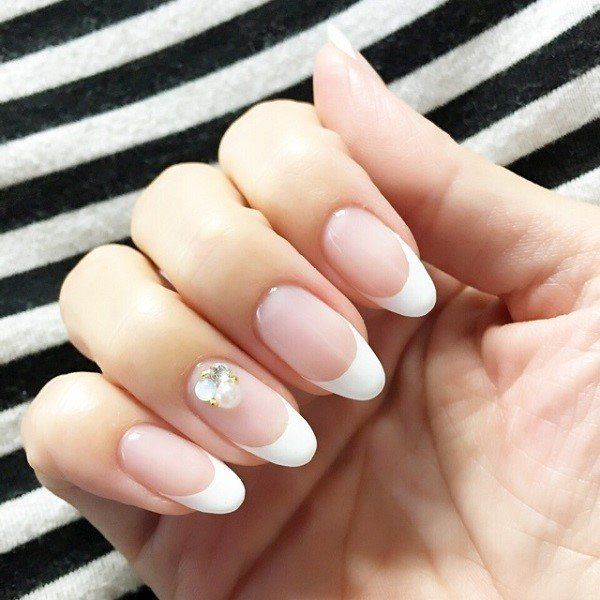 Here we see simple but also timeless French manicure, enriched just with a few zircons and pa pearl.