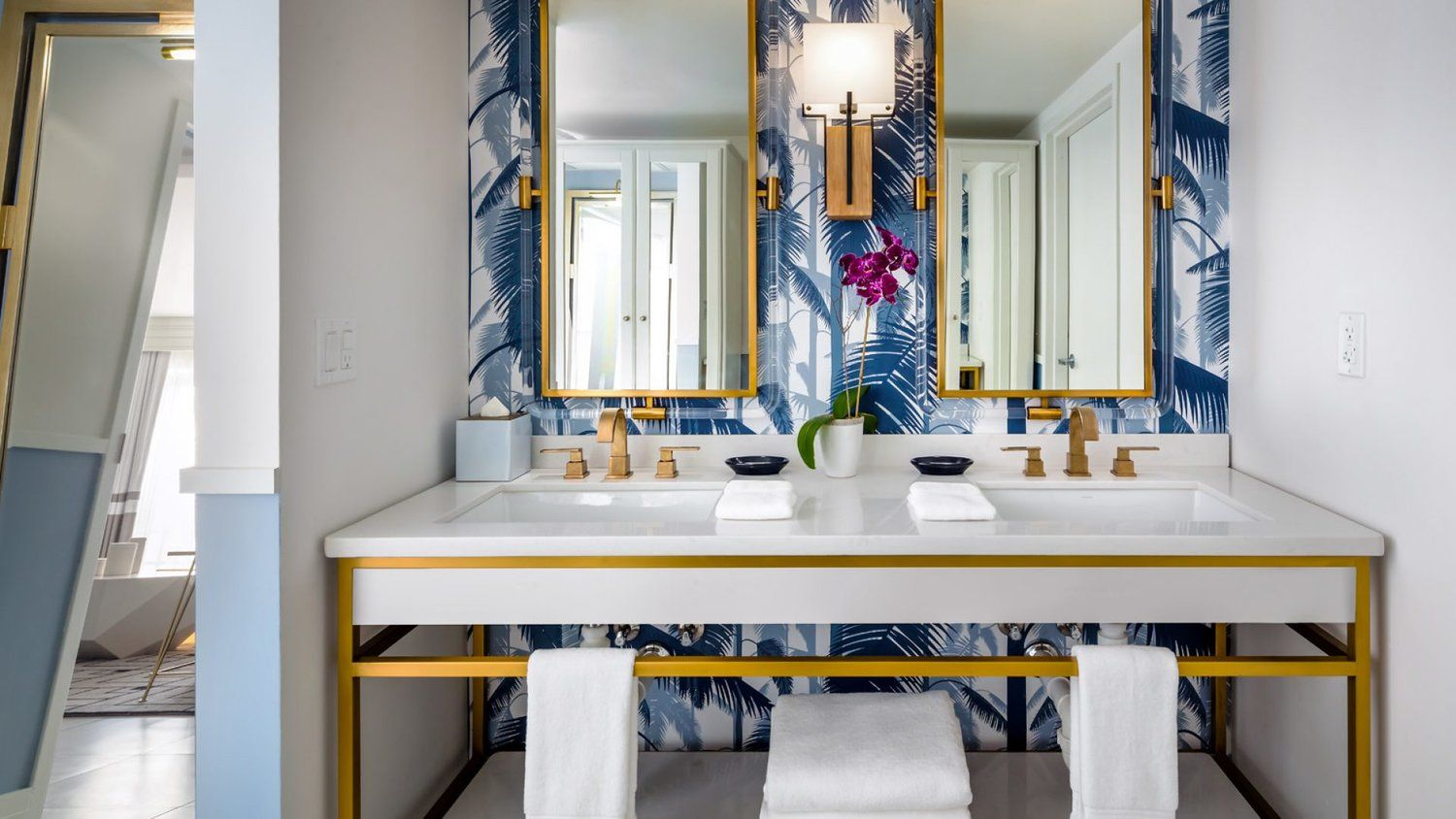Love this bathroom with the navy blue triangle tile shower
