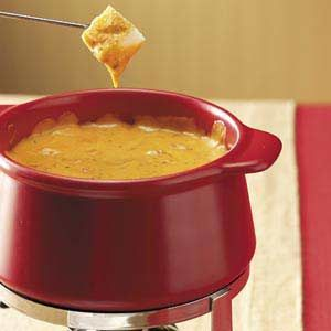 Pizza Fondue:  1/2-Cup Pepperoni, 1/2-tsp Basil, 1/2-tsp Oregano, 2-Cans Condensed Cheddar Cheese Soup, 1-sm Bottle Ragu Spaghetti Sauce, 1/2-Cup Milk, 1 1/2-Cups Shredded Pizza Cheese, 1/2-tsp Crushed Red Pepper Flakes.