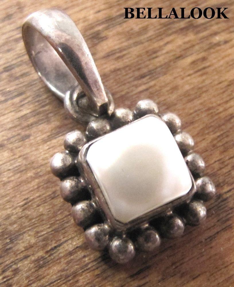 Silpada sterling silver frame pearl pendant pearl pendant silpada s1211 sterling silver button frame freshwater pearl pendant retired 36g silpada pendant aloadofball Images