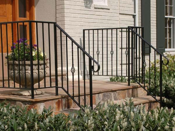 Wrought iron balustrade form this stair railing in - Wrought iron handrails for exterior stairs ...