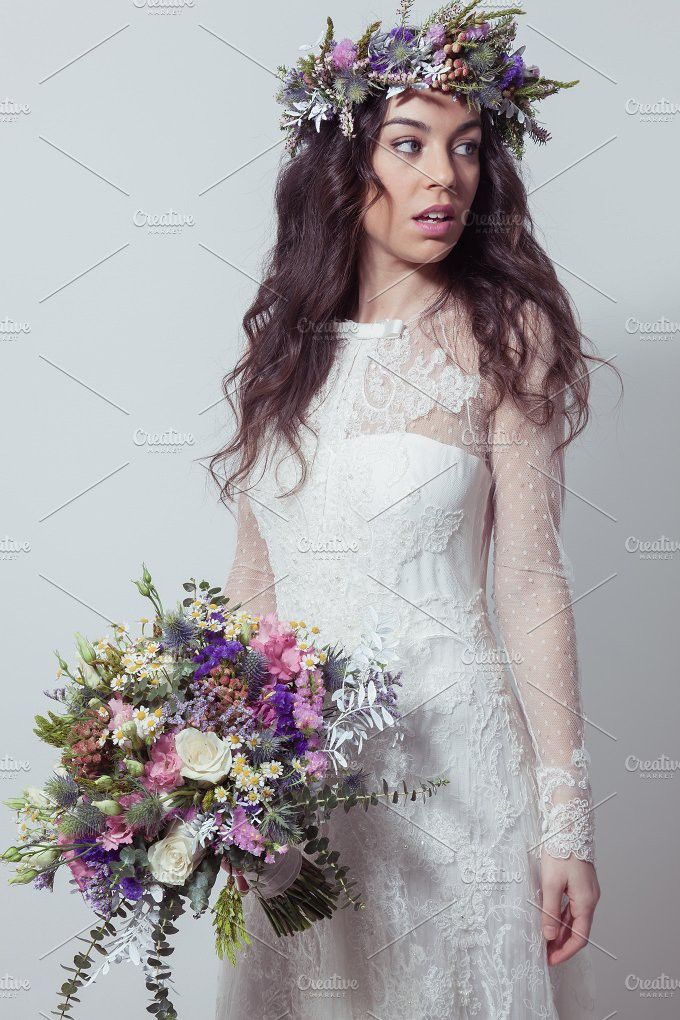 Bride with bouquet and flower crown. People Photos