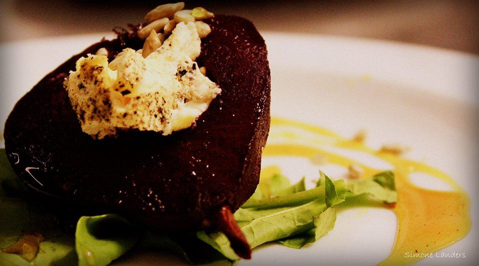 Chef Ray's Poached Pear with a mixed nut goats' cheese compote, sesame seed and honey dressing.