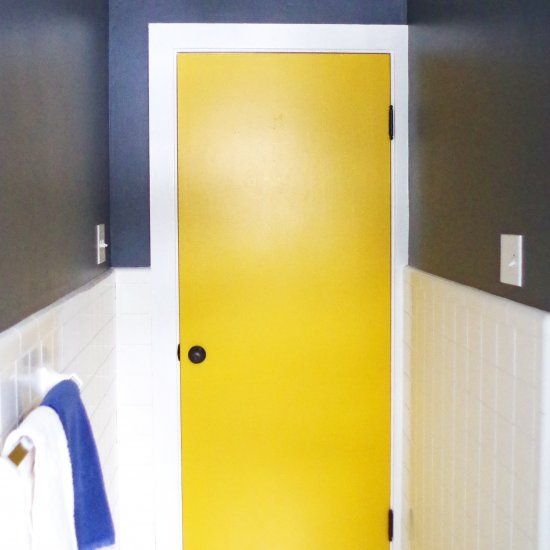 See how we made our ugly old doors fresh and fun with paint. Affordable upgrade!
